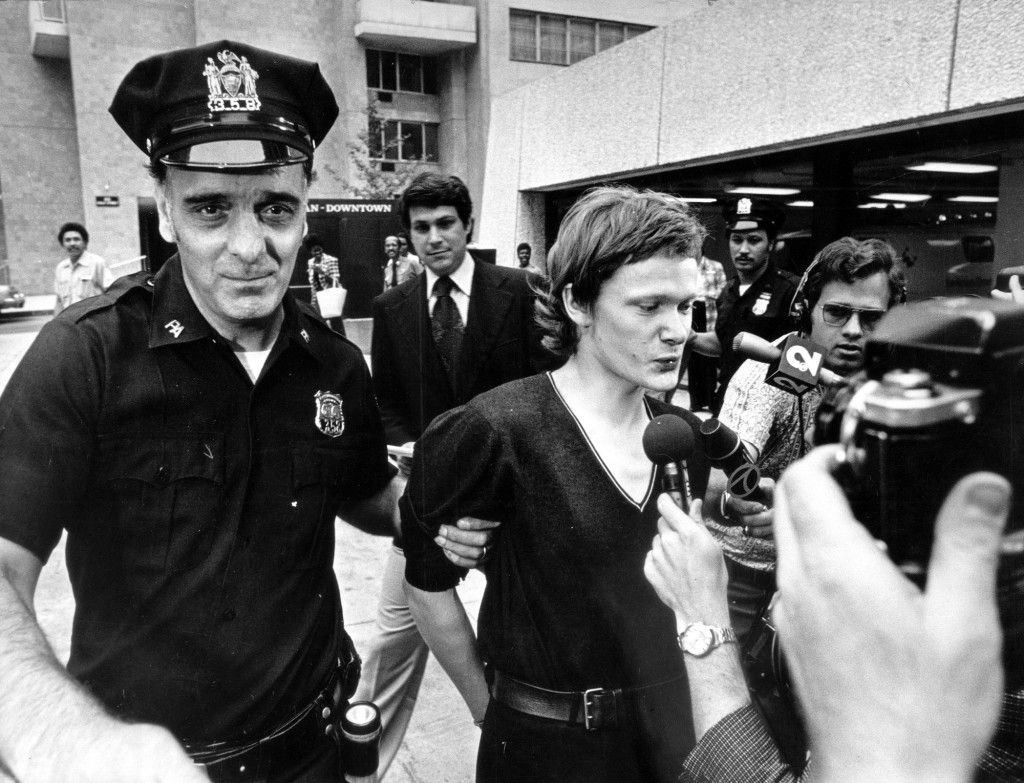 (NYT204) NEW YORK -- Aug. 12, 2002 -- 9-11-WTC-4 -- French high-wire artist Philippe Petit, center, is escorted from a downtown hospital where he was taken for evaluation following his arrest after walking a tightrope across the World Trade Center in 1974. He was released shortly thereafter. The twin towers were despised in some quarters as an overscaled boondoggle when construction began in 1973. What turned the tide of public regard was not the bigness of the place but the way it could be momentarily captured by fanciful gestures on a human scale. (Neal Boenzi/The New York Times)